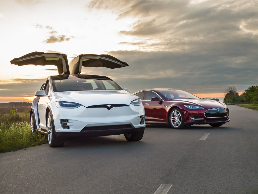 Tesla electric cars on a road